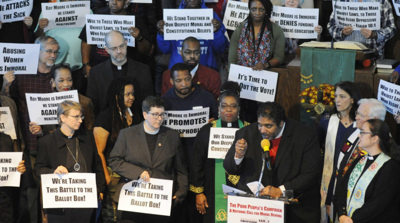The Rev. William J. Barber II, a leader of The Poor People's Campaign and a prominent voice among liberal Christians, speaks at a rally held in opposition to Republican U.S. Senate candidate Roy Moore at a church in Birmingham, Ala., on Saturday, Nov. 18, 2017. The demonstration came two days after conservative Christian leaders stood with Moore at another event. (AP Photo/Jay Reeves)