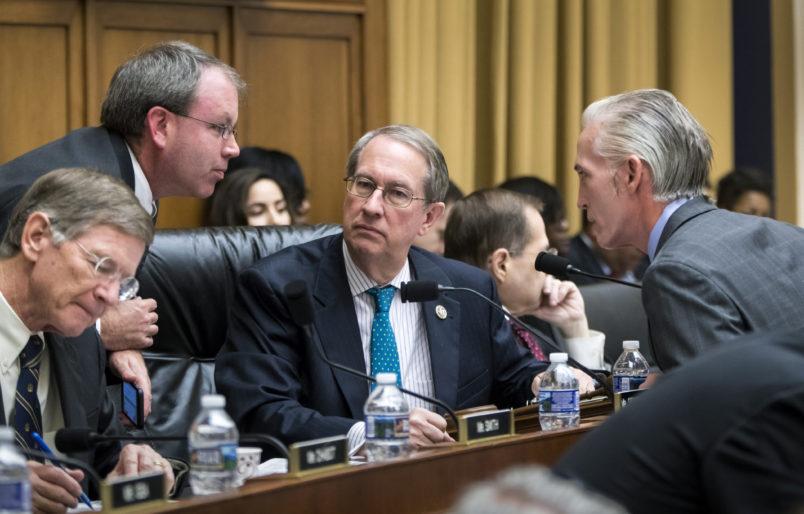 House Judiciary Committee Chairman Bob Goodlatte, R-Va., center, is joined by, from left, Rep. Lamar Smith, R-Texas, a staff aide, and Rep. Trey Gowdy, R-S.C., far right, as the panel meets to craft a Republican bill to expand gun owners' rights, the first gun legislation since mass shootings in Las Vegas and Texas killed more than 80 people, on Capitol Hill in Washington, Wednesday, Nov. 29, 2017.  (AP Photo/J. Scott Applewhite)