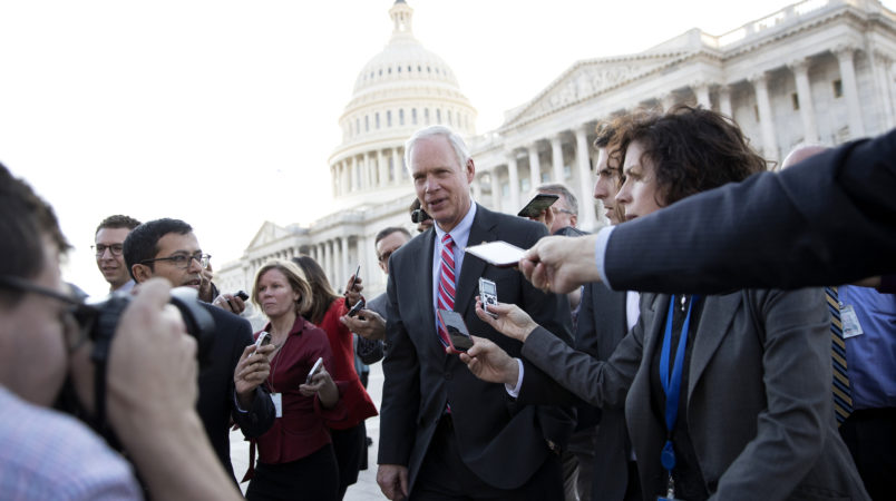 Sen. Ron Johnson, R-Wis., is surrounded by media as he walks from the Capitol building on Capitol Hill in Washington, Wednesday, Nov. 29, 2017. (AP Photo/Carolyn Kaster)