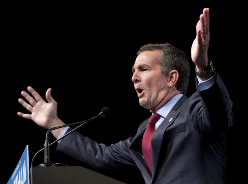 Democratic gubernatorial candidate Lt. Gov., Ralph Northam, gestures during a rally in Richmond, Va., Thursday, Oct. 19, 2017.  (AP Photo/Steve Helber)