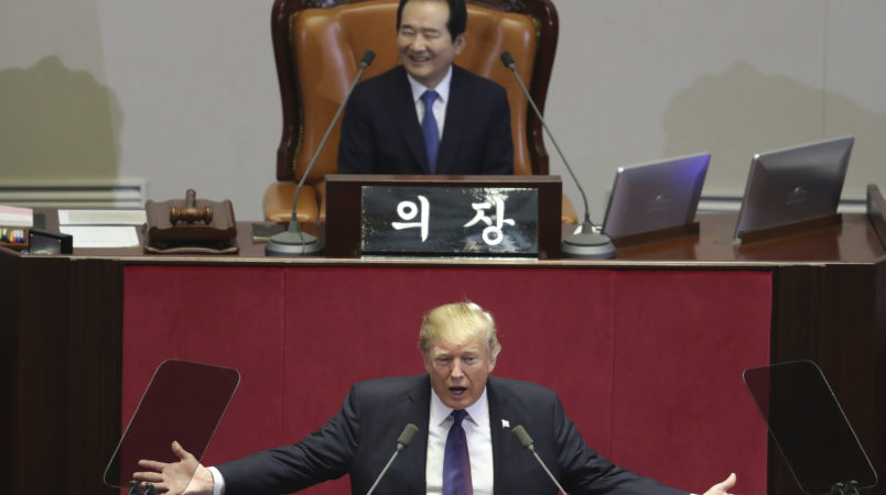 U.S. President Donald Trump delivers a speech as South Korea's National Assembly Speaker Chung Sye-kyun, top, listens at the National Assembly in Seoul, South Korea, Wednesday, Nov. 8, 2017. (AP Photo/Lee Jin-man, Pool)