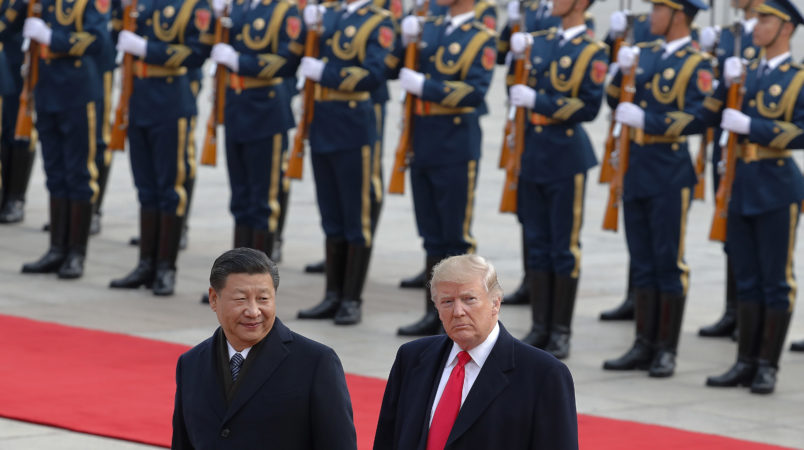 U.S. President Donald Trump, right, walks with Chinese President Xi Jinping during the welcome ceremony at the Great Hall of the people in Beijing, Thursday, Nov. 9, 2017. (AP Photo/Andy Wong)