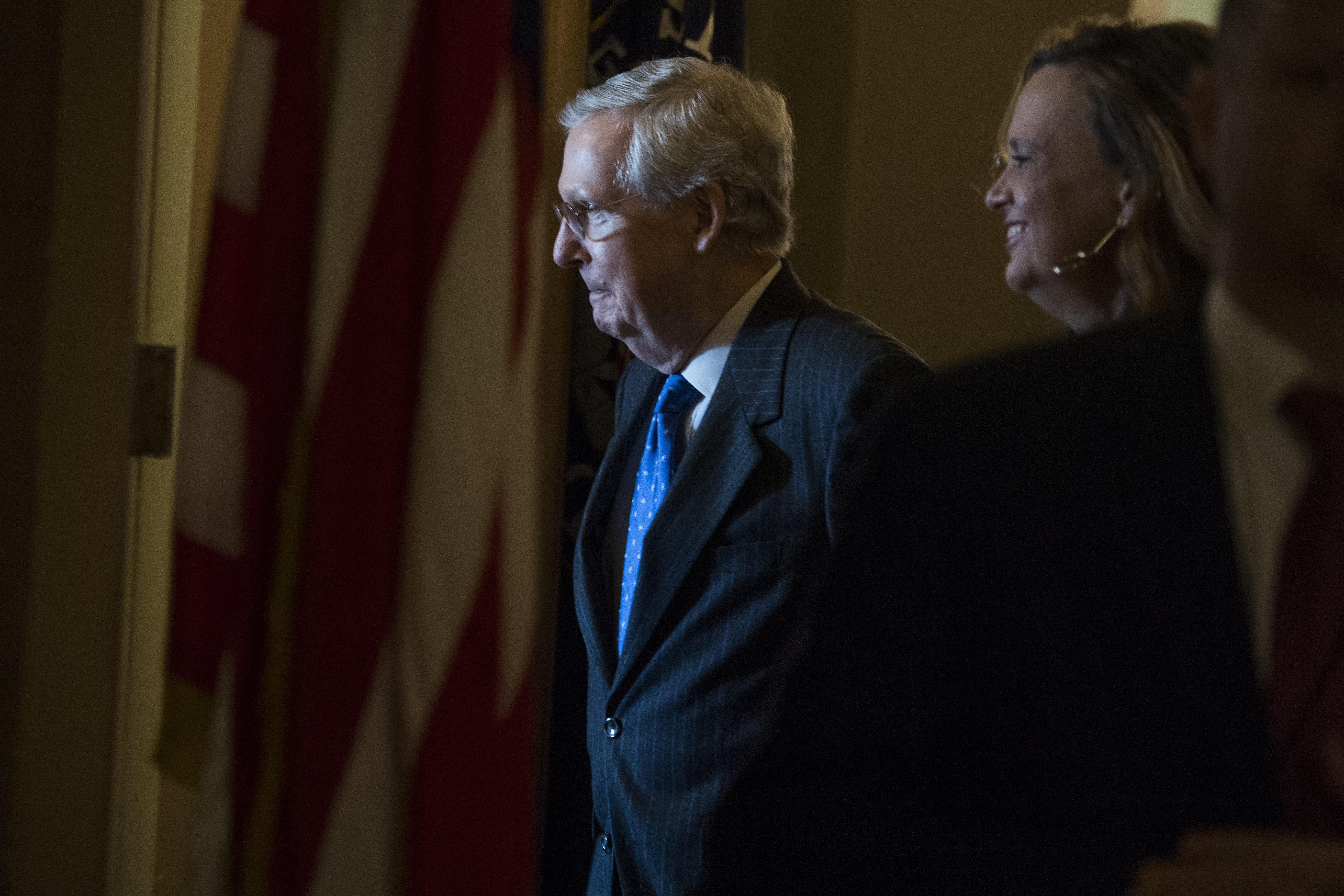 UNITED STATES - NOVEMBER 16: Senate Majority Leader Mitch McConnell, R-Ky., talks with an aide in the Capitol after the House passed the GOP's tax reform bill on November 16, 2017. (Photo By Tom Williams/CQ Roll Call)