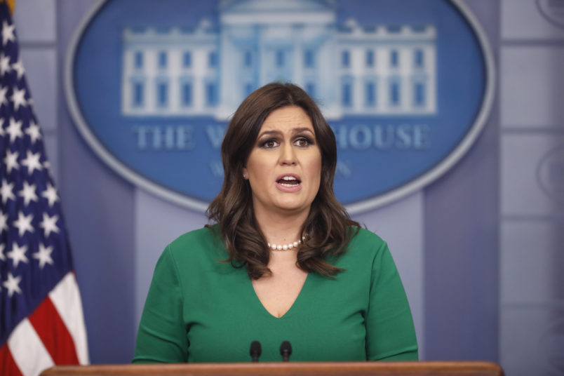 President Donald Trump and White House press secretary Sarah Huckabee Sanders speak to the media during the daily briefing in the Brady Press Briefing Room of the White House, Thursday, Nov. 16, 2017. (AP Photo/Pablo Martinez Monsivais)