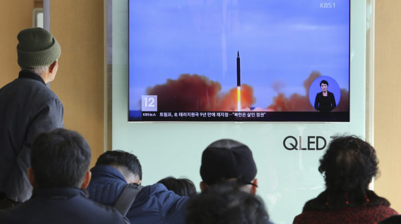"""People watch a TV screen showing a file footage of North Korea's missile launch, at Seoul Railway Station in Seoul, South Korea, Tuesday, Nov. 21, 2017. U.S. President Donald Trump announced Monday the U.S. is putting North Korea's """"murderous regime"""" on America's terrorism blacklist, despite questions about Pyongyang's support for international attacks beyond the assassination of its leader's half brother in February. (AP Photo/Ahn Young-joon)"""