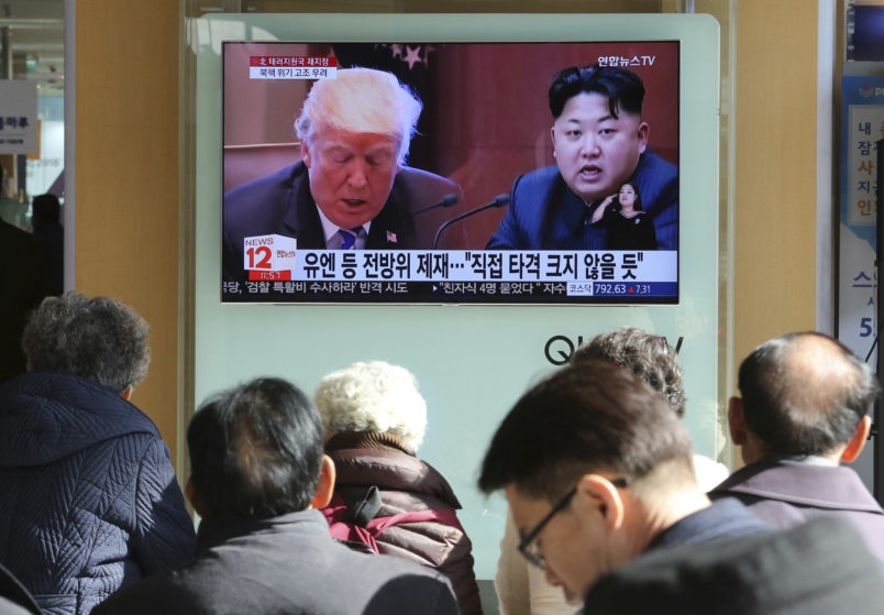 """FILE- In this Tuesday, Nov. 21, 2017, file photo, people watch a TV screen showing images of U.S. President Donald Trump, left, and North Korean leader Kim Jong Un at Seoul Railway Station in Seoul, South Korea. North Korea has called on Wednesday, Nov. 22, 2017,Trump's decision to relist the country as a state sponsor of terrorism a """"serious provocation"""" that justifies its development of nuclear weapons. The signs read """"UN sanctions and The blow is not big."""" (AP Photo/Ahn Young-joon, File)"""