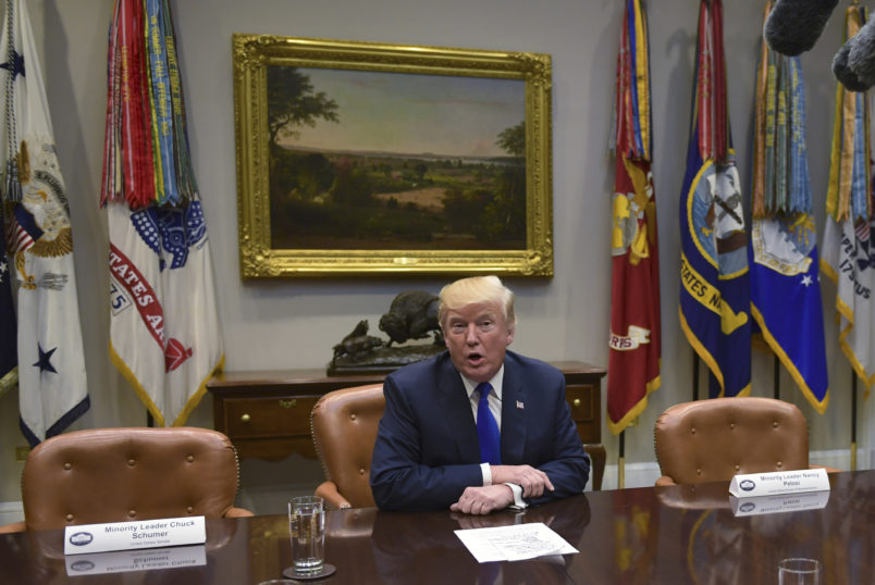 President Donald Trump, flanked by empty seats for Senate Minority Leader Sen. Chuck Schumer of N.Y., left, and House Minority Leader Nancy Pelosi of Calif., right, speaks in the Roosevelt Room of the White House in Washington, Tuesday, Nov. 28, 2017, during a meeting with Republican congressional leaders. (AP Photo/Susan Walsh)
