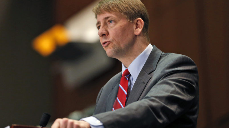 FILE - In this March 26, 2015, file photo, Consumer Financial Protection Bureau (CFPB) Director, Richard Cordray, speaks during a panel discussion in Richmond, Va. The CFPB is considering banning a practice known as forced arbitration for financial services. (AP Photo/Steve Helber, File)