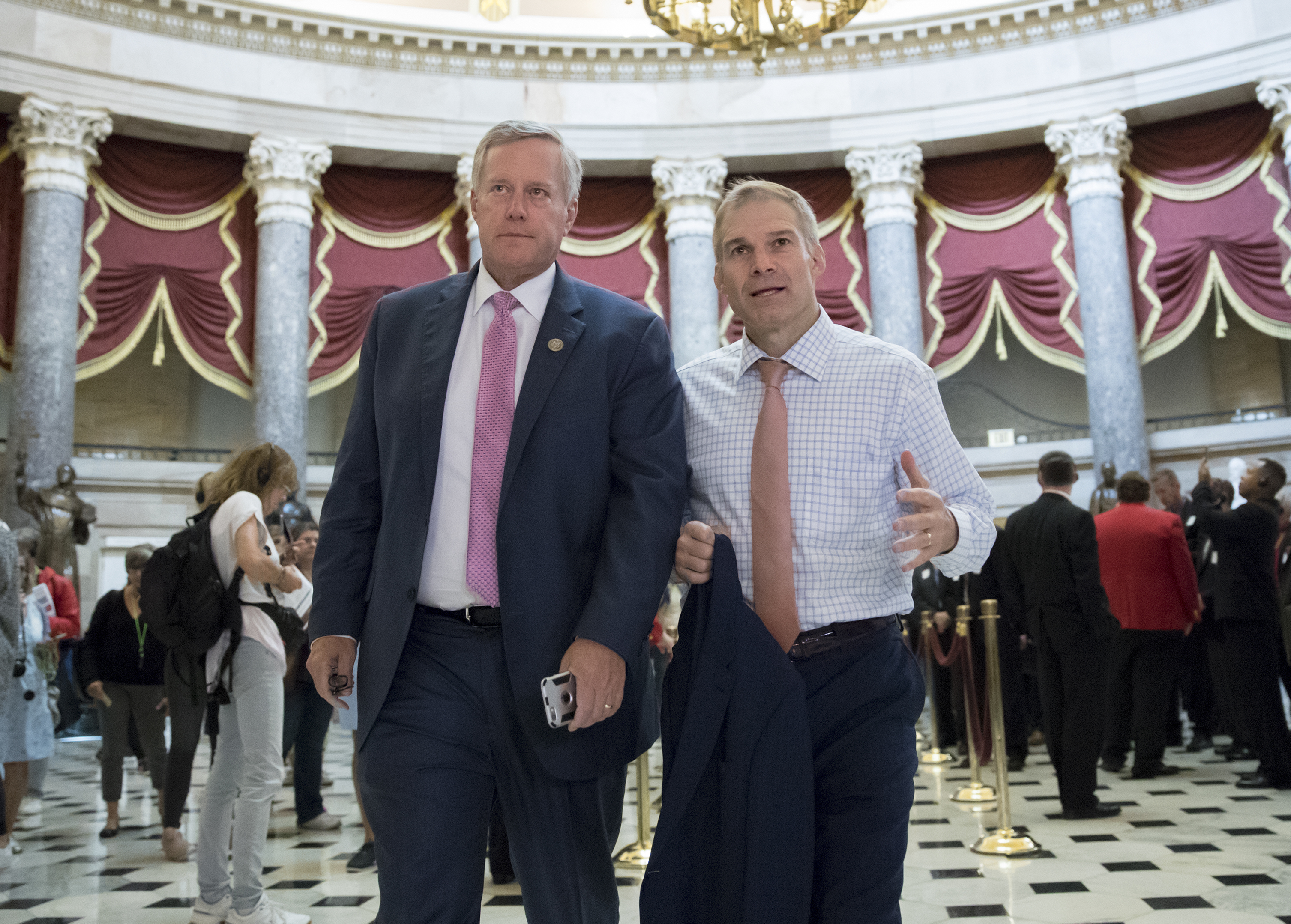 Rep. Mark Meadows, R-N.C., chairman of the conservative House Freedom Caucus, and Rep. Jim Jordan, R-Ohio, a key member of the group, walk through Statuary Hall at the Capitol in Washington, Wednesday, Sept. 13, 2017. With President Donald Trump wanting a legislative solution to replace the Deferred Action for Childhood Arrivals program, Meadows has said he will put together a working group to craft a conservative immigration plan. (AP Photo/J. Scott Applewhite)