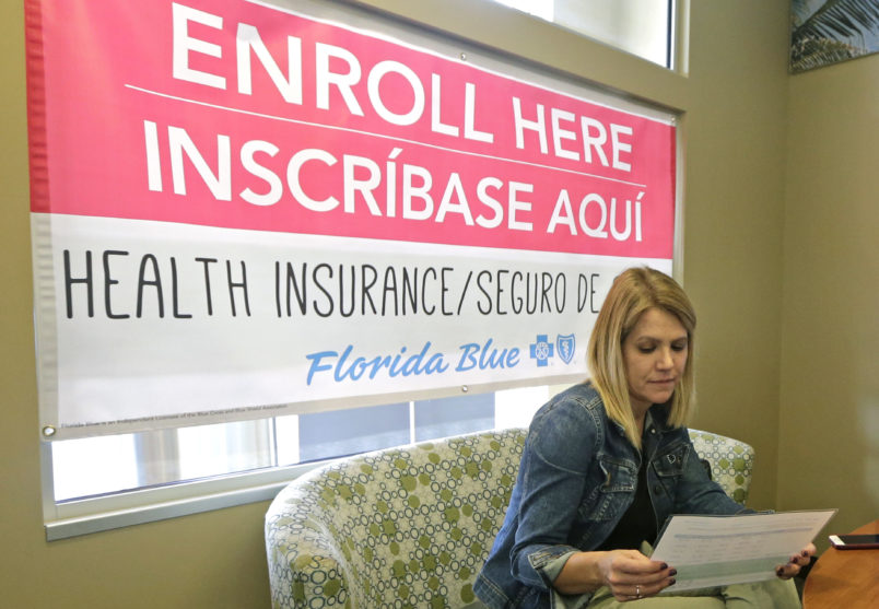Catherine Reviati reviews the different Affordable Care Act enrollment options, Thursday, Nov.2, 2017, in Hialeah, Fl. Health care advocacy groups are making an against-all-odds effort to sign people up despite confusion and hostility fostered by Republicans opposed to former President Barack Obama's signature domestic policy achievement. (AP Photo/Alan Diaz)
