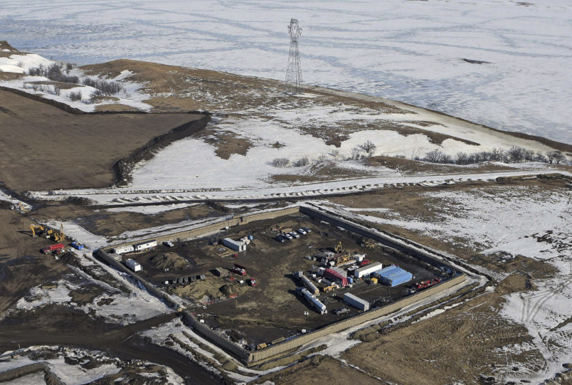 FILE - This Feb. 13, 2017, aerial file photo shows a site where the final phase of the Dakota Access Pipeline near the Missouri River took place with boring equipment routing the pipeline underground and across Lake Oahe to connect with the existing pipeline in Emmons County in Cannon Ball, N.D. A federal judge on Monday, Dec. 4, 2017, ordered the Army Corps of Engineers and pipeline developer Energy Transer Partners to complete an oil spill response plan for a section of the pipeline beneath the Missouri River in North Dakota. (Tom Stromme/The Bismarck Tribune via AP, File)
