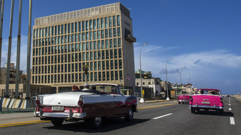 Tourists ride classic convertible cars on the Malecon beside the United States Embassy in Havana, Cuba, Tuesday, Oct. 3, 2017. Thousands of private Cuban businesses have invested heavily in private homes, cars and restaurants, hoping to cash in on an expected wave of American travelers to the island. Now that the U.S. State Department has issued a travel warning for the country, their investments are at risk.(AP Photo/Desmond Boylan)