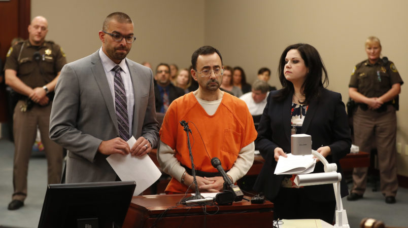 Dr. Larry Nassar, 54, appears in court for a plea hearing in Lansing, Mich., Wednesday, Nov. 22, 2017. Nasser, a sports doctor accused of molesting girls while working for USA Gymnastics and Michigan State University pleaded, guilty to multiple charges of sexual assault and will face at least 25 years in prison.(AP Photo/Paul Sancya)