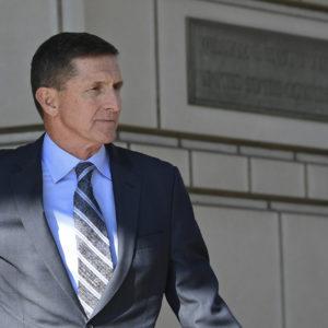 Former Trump national security adviser Michael Flynn leaves federal court in Washington, Friday, Dec. 1, 2017. (AP Photo/Susan Walsh)
