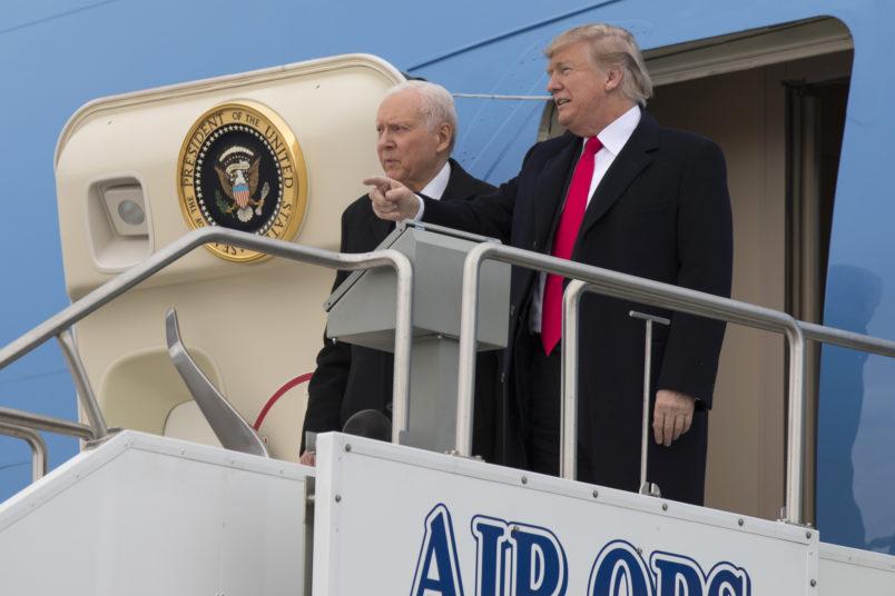 President Donald Trump stands with Sen. Orrin Hatch, R-Utah, after arriving at Salt Lake City International Airport, Monday, Dec. 4, 2017, in Salt Lake City. (AP Photo/Evan Vucci)