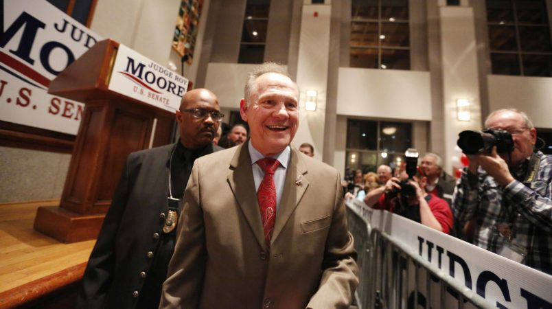 U.S. Senate candidate Roy Moore greets supporters during an election-night watch party at the RSA activity center, Tuesday, Dec. 12, 2017, in Montgomery, Ala. (AP Photo/Brynn Anderson)