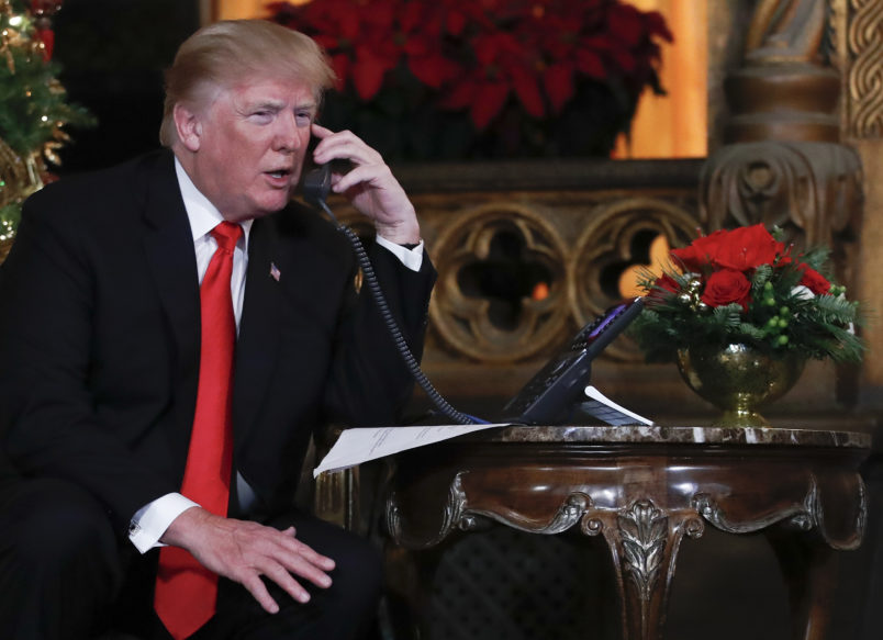 President Donald Trump speaks on the phone with children as they track Santa's movements with the North American Aerospace Defense Command (NORAD)  Santa Tracker on Christmas Eve at the president's Mar-a-Lago estate in Palm Beach, Fla., Sunday, Dec. 24, 2017. (AP Photo/Carolyn Kaster)