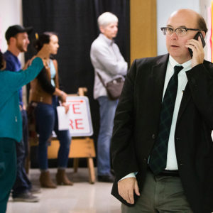 PORTLAND, ME - NOVEMBER 8: Maine Secretary of State Matthew Dunlap fields a phone call during one of several election day stops, to see how the polling process is going, at the Merrill Auditorioun Rehearsal Hall voting location in Portland on Tuesday, November 8, 2016. (Photo by Carl D. Walsh/Staff Photographer)