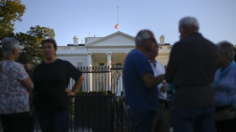 The U.S. flag is seen lowered to half staff above the White House in Washington, Monday, Oct. 2, 2017. President Donald Trump ordered that flags be lowered at all government buildings to honor the victims of a mass shooting in the Las Vegas attacks. (AP Photo/Pablo Martinez Monsivais)