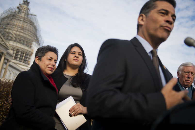 UNITED STATES - DECEMBER 04: From left, Clarissa Martinez-De-Castro of the National Council of La Raza, Lorella Praeli of United We Dream, Chairman of the House Democratic Caucus Rep. Xavier Becerra, D-Calif., House Minority Whip Steny Hoyer, D-Md., attend a news conference at the House Triangle, to call on House Republicans to pass a comprehensive immigration reform bill, December 4, 2014. (Photo By Tom Williams/CQ Roll Call)