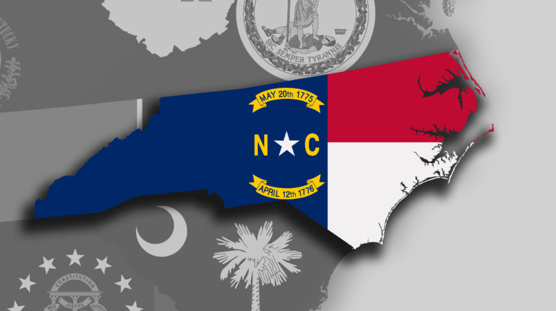 Illustration of the State of North Carolina silhouette map and flag. Its a JPG image.