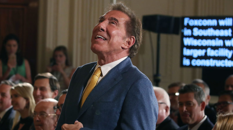"""WASHINGTON, DC - JULY 26:  Steve Wynn, CEO of Wynn Resorts, is acknowledged at a news conference held by U.S. President Donald Trump in the East Room of the White House July 26, 2017 in Washington, DC. The president was touting a decision by Apple supplier Foxconn to invest $10 billion to build a factory in Wisconsin that produces LCD panels. Foxconn said the project would create 3,000 jobs, with the """"potential"""" to generate 13,000 new jobs, according to published reports.  (Photo by Mark Wilson/Getty Images)"""