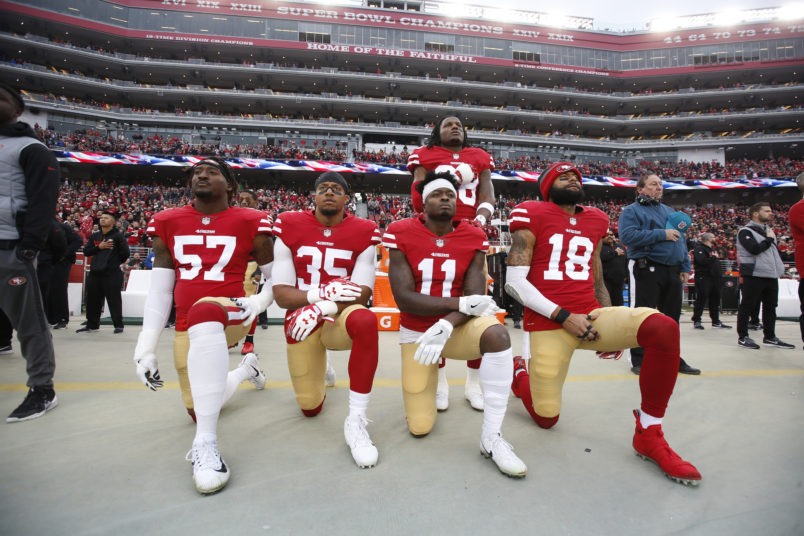 SANTA CLARA, CA - DECEMBER 24: Eli Harold #57, Eric Reid #35, Marquise Goodwin #11 and Louis Murphy #18 of the San Francisco 49ers kneel on the sideline as Adrian Colbert #38 stands with them in solidarity, during the anthem, prior to the game against the Jacksonville Jaguars at Levi's Stadium on December 24, 2017 in Santa Clara, California. The 49ers defeated the Jaguars 44-33. (Photo by Michael Zagaris/San Francisco 49ers/Getty Images)  *** Local Caption *** Eli Harold;Eric Reid;Marquise Goodwin;Louis Murphy;Adrian Colbert