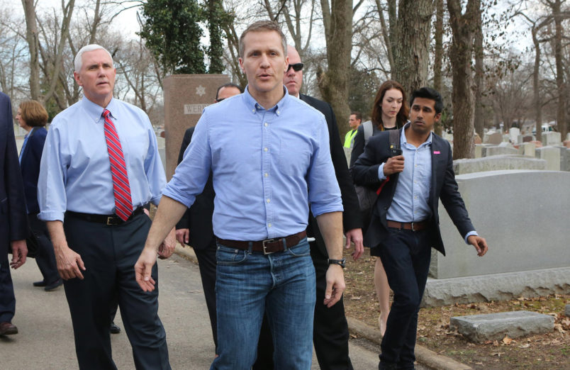Vice President Mike Pence and Missouri Gov. Eric Greitens walk through the Chesed Shel Emeth Cemetery in University City, Mo., on Wednesday, Feb. 22, 2017. A St. Louis County attorney filed a lawsuit last week accusing Gov. Eric Greitens and his staff of engaging in an ongoing conspiracy to violate Missouri's open records laws by using an app that deletes text messages after they've been read. (J.B. Forbes/St. Louis Post-Dispatch/TNS)