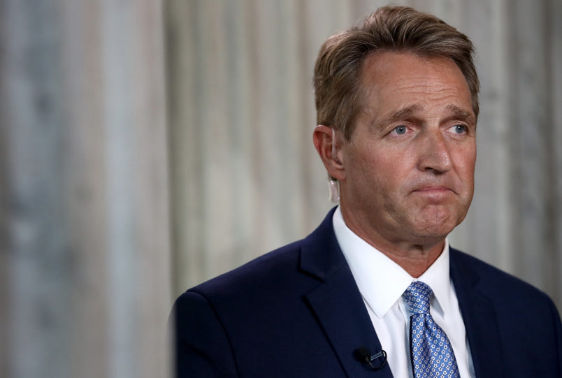 Sexual assault survivors confront Jeff Flake after announcing he'll confirm Brett Kavanaugh