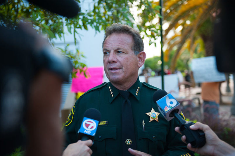 2015 June 23 Broward County Sheriff Scott Israel.  Local activitists in Fort Lauderdale, Florida lead a rally to commemorate the lives of the nine black churchgoers who lost their lives.  With our nation grappling over racist violence., local activist groups include Dream Defenders and People's Opposition to War, Imperialism, and Racism ( or POWIR) came together with members of the community.  Candles were lit and the group walked to a near by church to pray.