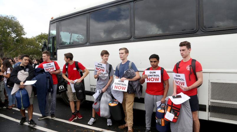 Students from Marjory Stoneman Douglas High School get ready to board a bus for a trip to Tallahassee, Fla. on Tuesday, Feb. 20, 2018 to talk with lawmakers about the recent rampage at their school and what needs to be done to make sure it doesn't happen again. (Mike Stocker/Sun Sentinel/TNS)
