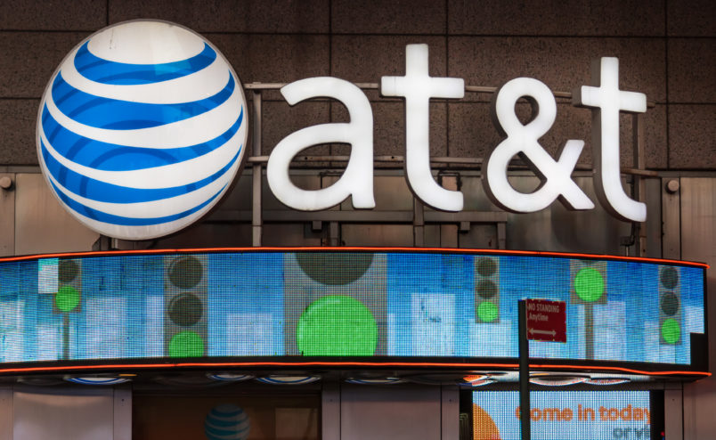 NEW YORK CITY, NEW YORK, UNITED STATES - 2015/10/17: AT&T office New York City, USA: Signage and logo outside its office glowing at night.AT&T Inc. is an American multinational telecommunications corporation, headquartered at Whitacre Tower in downtown Dallas, Texas. (Photo by Roberto Machado Noa/LightRocket via Getty Images)