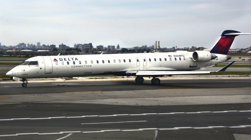 NEW YORK, NY - SEPTEMBER 21, 2017:  A Delta Connection passenger jet (Bombardier CRJ-900LR) taxis at LaGuardia Airport in New York, New York. (Photo by Robert Alexander/Getty Images)