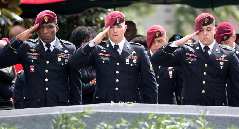 Members of the 3rd Special Forces Group Airborne 2nd Battalion leave pins and salute the casket after the burial of Army Sgt. La David Johnson at Fred Hunter's Hollywood Memorial Gardens in Hollywood, Fla., on Saturday, Oct. 21, 2017. (Mike Stocker/Sun Sentinel/TNS)