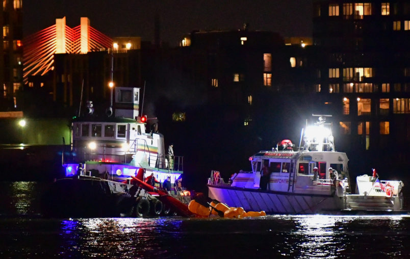 NEW YORK, NY - MARCH 11:  Emergency responders work at the scene of a helicopter crash in the East River March 11, 2018 in New York City. Five people have died after the helicopter crashed and flipped upside down in the water.  (Photo by James Devaney/Getty Images)