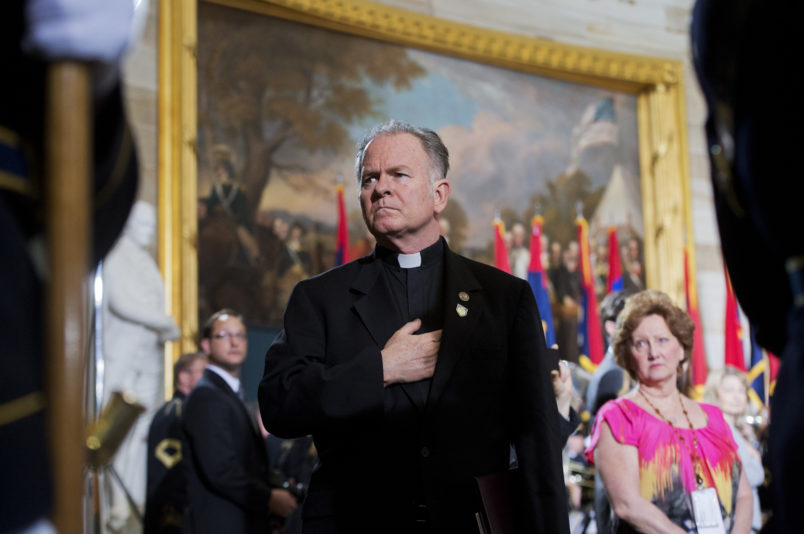UNITED STATES - APRIL 11: Rev. Patrick Conroy, Chaplain of the House, attends the 2013 National Days of Remembrance ceremony in the Capitol rotunda to honor the victims of the Holocaust. (Photo By Tom Williams/CQ Roll Call)