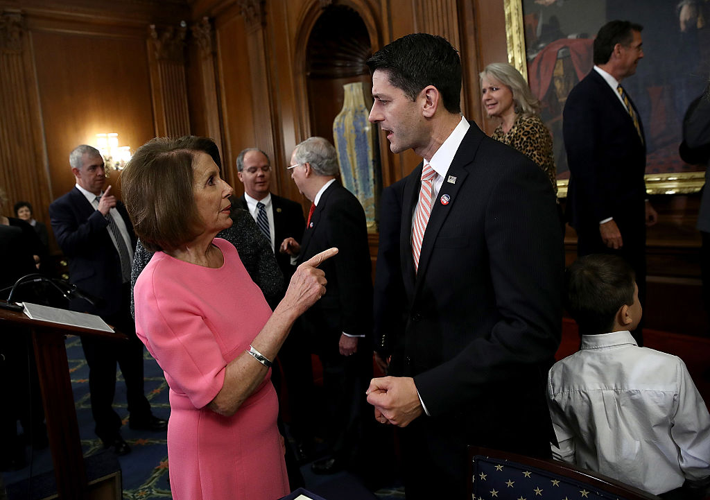 WASHINGTON, DC - DECEMBER 08:  U.S. Speaker of the House Paul Ryan (R) (R-WI) speaks with House Minority Leader Rep. Nancy Pelosi (D-CA) following an event marking the passage of the 21st Century Cures Act at the U.S. Capitol December 8, 2016 in Washington, DC. The bill, passed with strong bipartisan support, provides funding for cancer research, the fight against the epidemic of opioid abuse, mental health treatment, aids the Food and Drug Administration in expediting drug approvals and pushes for better use of technology in medicine.  (Photo by Win McNamee/Getty Images)