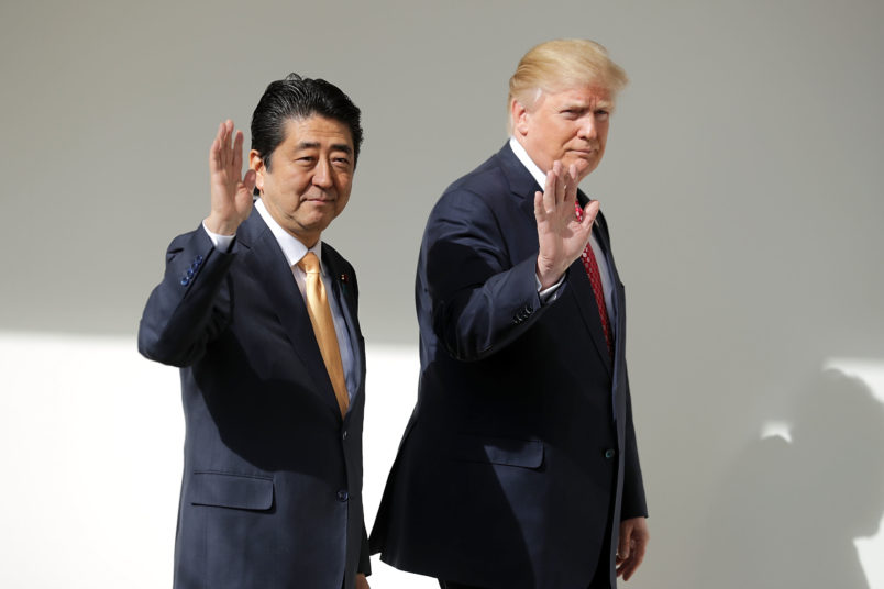 (AFP OUT) U.S. President Donald Trump and Japanese Prime Minister Shinzo Abe pose for photographs before bilateral meetings in the Oval Office at the White House February 10, 2017 in Washington, DC. Trump and Abe are expected to discuss many issues, including trade and security ties and will hold a joint press confrence later in the day.