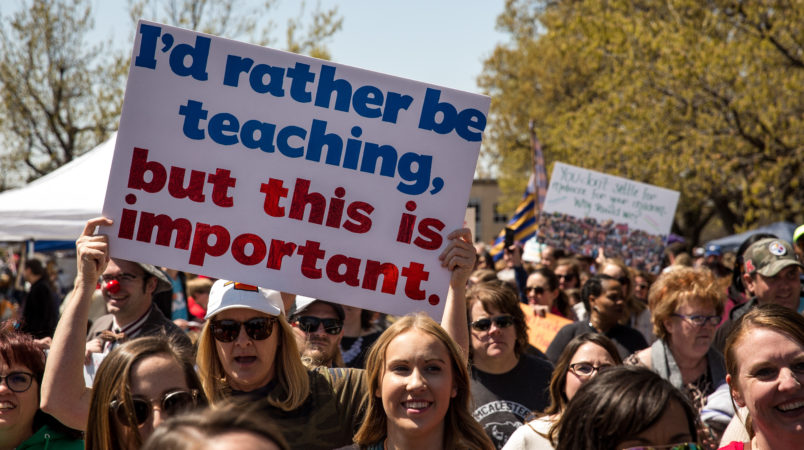 OKLAHOMA CITY, OK - APRIL 04: Thousands gathered and marched in a pitcket line outside the Oklahoma state Capitol building during the third day of a statewide education walkout on April 4, 2018 in Oklahoma City, Oklahoma. Teachers and their supporters are demanding increased school funding and pay raises for school workers. (Photo by Scott Heins/Getty Images)