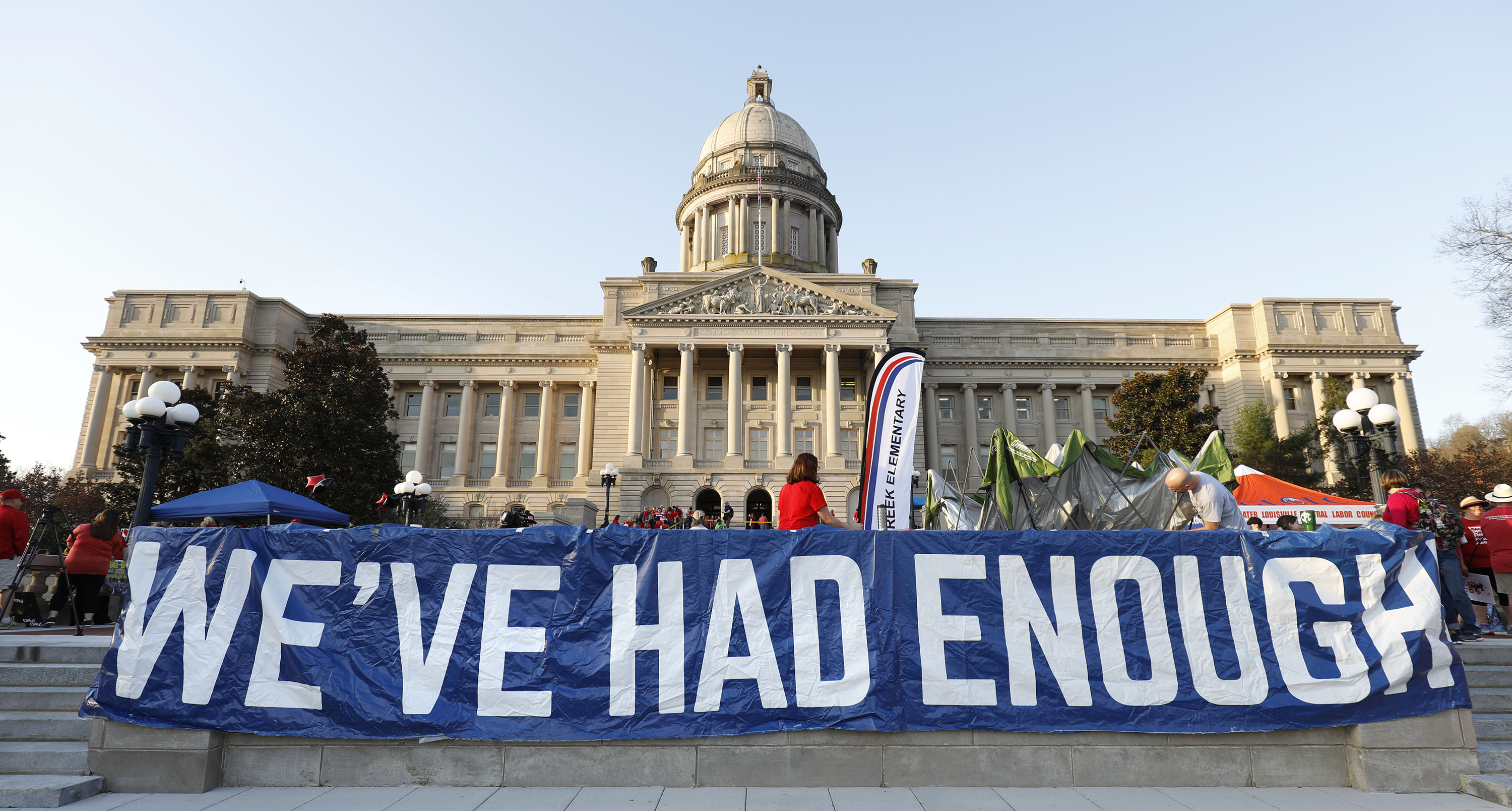 "FRANKFORT, KY-APRIL 13: Kentucky Public school teachers rally for a ""day of action"" at the Kentucky State Capitol to try to pressure legislators to override Kentucky Governor Matt Bevin's recent veto of the state's tax and budget bills April 13, 2018 in Frankfort, Kentucky. The teachers also oppose a controversial pension reform bill which Gov. Bevin signed into law. (Bill Pugliano/Getty Images)"