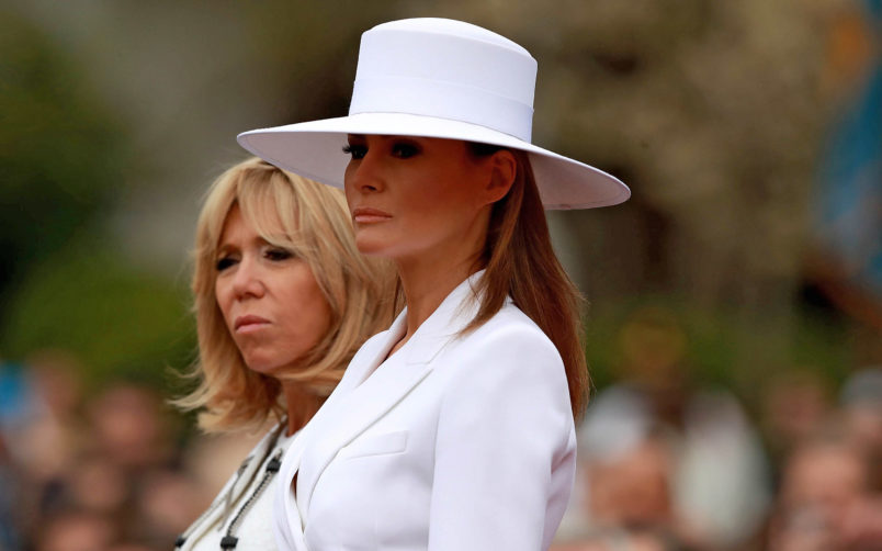 WASHINGTON, DC - APRIL 24:  U.S. first lady Melania Trump and Brigitte Macron take part in a state arrival ceremony at the White House April 24, 2018 in Washington, DC. French President Emmanuel Macron and U.S. President Donald Trump are scheduled to meet throughout the day to discuss a range of bilateral issues as Trump holds his first official state visit with the French president.  (Photo by Chip Somodevilla/Getty Images)