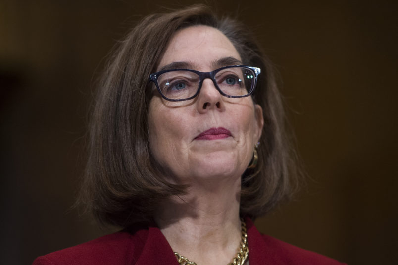 """UNITED STATES - MARCH 08: Gov. Kate Brown, D-Ore.,  prepares to testify during a Senate Health, Education, Labor, and Pensions Committee hearing in Dirksen Building titled """"The Opioid Crisis: Leadership and Innovation,"""" on March 08, 2018. (Photo By Tom Williams/CQ Roll Call)"""