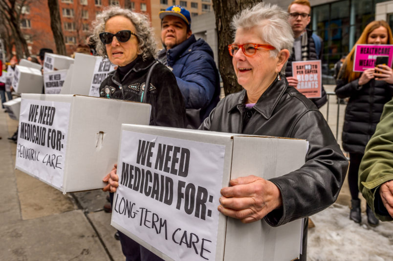 NYC FEDERAL BUILDING AT 26 FEDERAL PLAZA, NEW YORK, NY, UNITED STATES - 2017/03/21: Protesters holding boxes with a print on it. Outside the NYC Federal Building (26 Federal Plaza, Bway between Worth and Duane), which contains Medicaid offices, hundreds of New Yorkers who rely on Medicaid, including seniors and people with disabilities, will conduct political theater to protest congressional Republicans' plan to remake Medicaid. (Photo by Erik McGregor/Pacific Press/LightRocket via Getty Images)