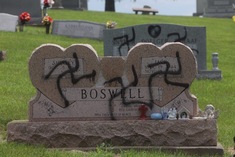 Swastikas were spray-painted on at least 150 headstones and grave markers at a cemetery in Glen Carbon on Saturday, May 26, 2018. Police said swastikas were also spray-painted on several homes nearby. (Photo by Laurie Skrivan/Post-Dispatch)