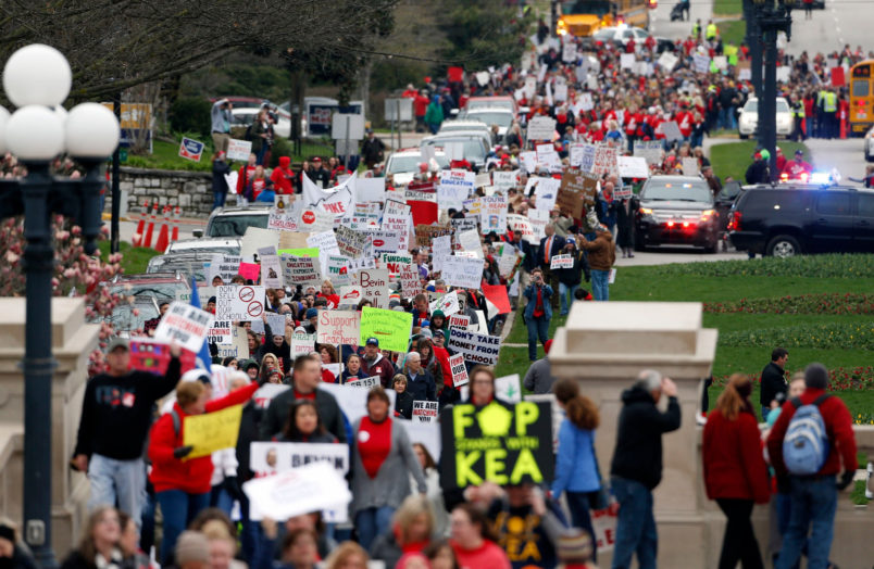 Thousands of Kentucky school teachers marched Monday, April 2, 2018 from the Kentucky Education Association's headquarters to the State Capitol in Frankfort, Ky. to protest legislative changes to their pensions and education cuts. Public schools in all 120 Kentucky counties were closed Monday, either to join in the protest or because of spring break. (Charles Bertram/Lexington Herald-Leader/TNS)