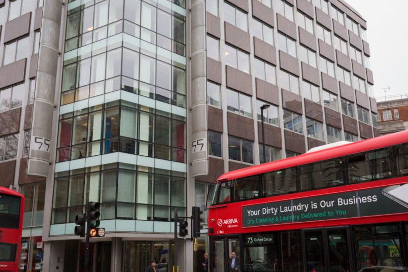 A London bus with an ad for dirty washing drives past the offices of Cambridge Analytica on New Oxford Street, the UK tech company accused of harvesting the personal details of Facebook users in its data privacy scandal, on 11th April, 2018, in London, England. (Photo by Richard Baker / In Pictures via Getty Images)