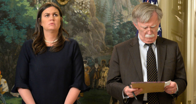White House Press Secretary Sarah Huckabee Sanders (L) and National Security Advisor John Bolton listen to remarks by President Donald Trump as he speaks to the nation, announcing military action against Syria for the recent gas attack on civilians, at the White House, April 13, 2018, in Washington, DC.        ISP POOL Photo by Mike Theiler/UPI
