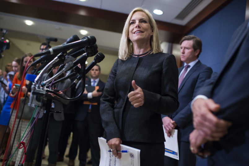 UNITED STATES - MAY 22: Homeland Security Secretary Kirstjen Nielsen, and Rep. Michael McCaul, R-Texas, chairman of the House Homeland Security Committee, off camera, address the media after briefing on election security with House members in the Capitol Visitor Center May 22, 2018. FBI Director Christopher Wray and National Intelligence Director Dan Coats also attended. (Photo By Tom Williams/CQ Roll Call)