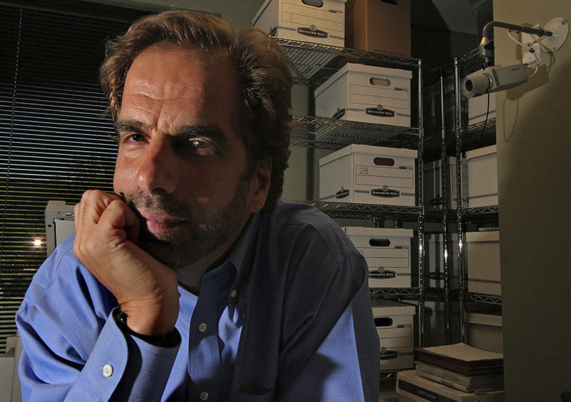 FILE - In this Friday, June 29, 2007, file photo, Dr. Steven Pitt poses in Scottsdale, Ariz. Pitt, a forensic psychiatrist, recently teamed up with the Arizona Humane Society to help the group better understand the mind-set of animal abusers. Authorities say the fatal shootings of two paralegals in a Phoenix suburb are related to the killing of a well-known forensic psychiatrist in Phoenix, and police are investigating if a fourth homicide is related. Scottsdale police Sgt. Hoster says the killings Friday of 48-year-old Veleria Sharp and 49-year-old Laura Anderson are connected to the shooting death a day earlier of Dr. Steven Pitt. The women and Pitt were killed outside their Scottsdale offices. (AP Photo/East Valley Tribune via AP, File)