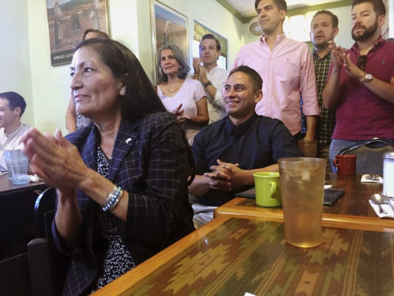 New Mexico's Democratic nominee to U.S. Congress, Debra Haaland, left, applauds at a celebratory breakfast in Albuquerque, N.M., on Wednesday, June 6, 2018, seated alongside state Sen. Howie Morales, who was nominated to run for lieutenant governor in the fall general election. Tuesday's primary elections upended the political landscape in New Mexico by setting up general-election showdowns between women in two open congressional seats and casting aside an incumbent Democratic state lawmaker who is embroiled sexual harassment accusations.(AP Photo/Morgan Lee)